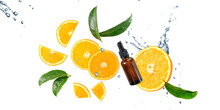 Dark Brown Glass Bottle Of Face Serum With Vitamin C Or Essential  Oil And Orange Fruit  Slices With Leaves In Splashing Water