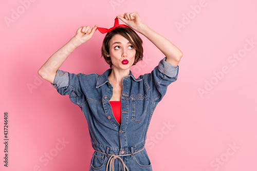 Obraz na płótnie Portrait of attractive funny girlish girl fixing headband pout lips isolated ove