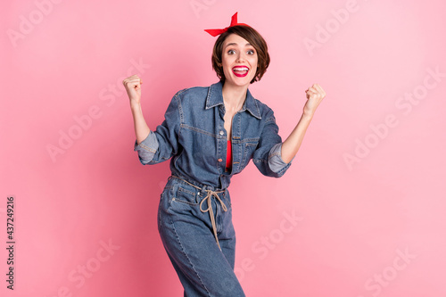 Tablou Canvas Portrait of attractive funky cheerful brown-haired girl celebrating best luck ha