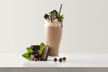 Chocolate Milkshake With Cream Decorated With Fruit On Table Isolated
