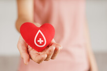 Woman Hands Holding Red Heart With Blood Donor Sign. Healthcare, Medicine And Blood Donation Concept.