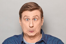 Portrait Of Surprised Bewildered Mature Man Making Goofy Funny Face