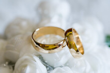 Golden Real Wedding Rings On A Wedding Background Representing Love Ready For The Bride And Groom.