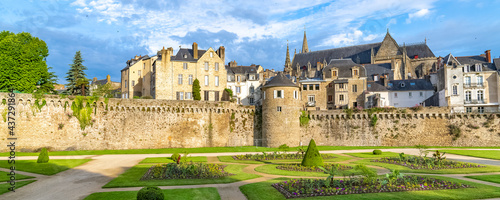 Photo Vannes, old houses in the ramparts garden, with the cathedral in background