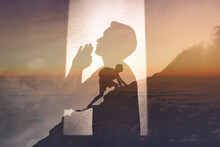 Young Man Praying To God For Strength To Get Through Difficult Times
