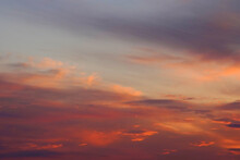 Colorful Fine Fluffy Clouds On Blue Sky At Sunset. Mix Of Bright And Pastel Shades Of Colors