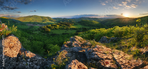 Fotografie, Obraz Green spring mountain landscape with sun and rocks - panorama