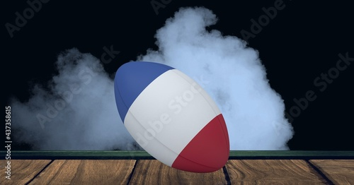 Compostion of rugby ball of france flag on black background with white smoke