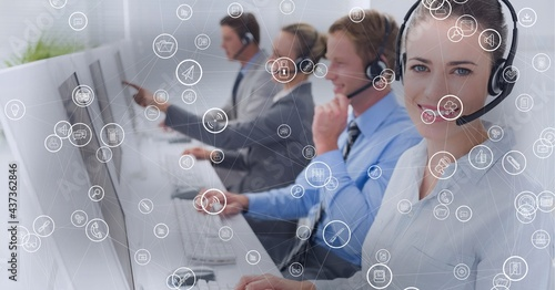 Composition of network of connections with icons over businesswoman using phone headset in office