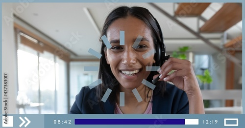 Composition of businesswoman talking on headset on video playback interface screen