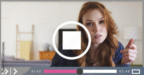 Composition of businesswoman talking on video playback interface screen