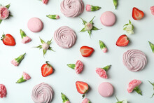 Concept Of Tasty Macaroons And Marshmallows On White Background
