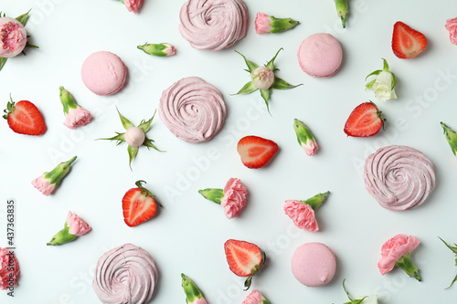 Concept of tasty macaroons and marshmallows on white background Fototapeta