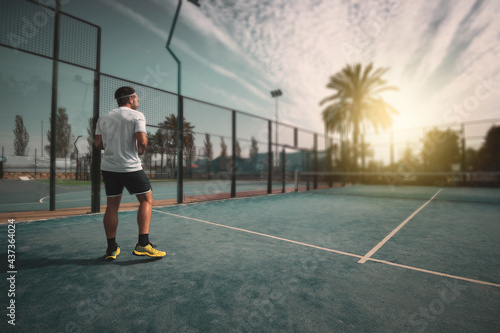 Canvas Print a young boy posing on an outdoor sports court