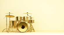 Gold Drum Kit On Yellow Wall