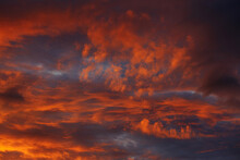 Orange Sky With Clouds At Sunset
