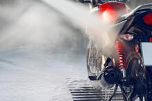 Washing A Motorcycle At A Self-service Car Wash.