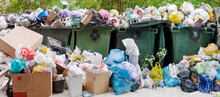 Overloaded Dumpster, Full Garbage Container, Household Garbage Bin, Trash Can, Heap Of Unsorted Rubbish: Plastic Bags, Food, Paper, Glass Bottles, Metal Scrap, Pile Of Refuse, Litter, Waste Management