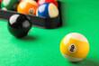 Leinwandbild Motiv Billiard ball with number 9 on green table, closeup. Space for text