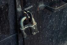 Padlock On An Old Iron Black Door