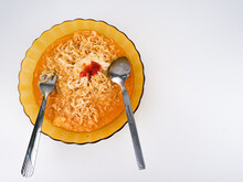 Maggie Curry In A Bowl With Scrambled Eggs. Isolate With White Background And Negative Space.