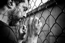 Young Man Behind Bars