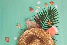 Wicker Summer Bag With Beach Accessories Sunglasses, Cosmetics And Shells, With Palm Leaf On Turquoise Background, Summer Background