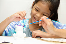 Asian Child Painting Statue On Holiday For Family Activity