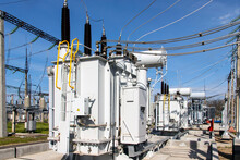 A Powerful Transformer Substation With Many Connected High-voltage Wires And Cables, Transformers Of Various Capacities And Voltages.