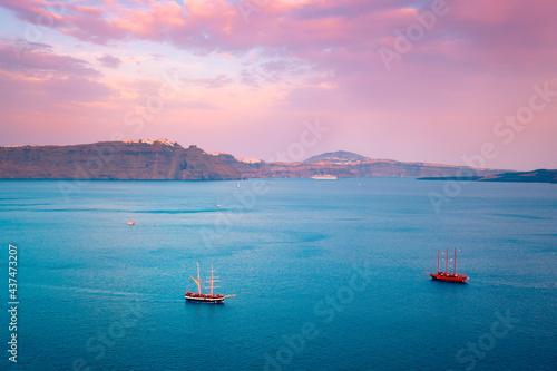 Fototapeta Schooner vessel ship boat in Aegean sea near Santorini island with tourists goin