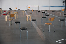 The Chair And Stool Is Arranged In New Normal Style For Social Distancing Which One Of The Coivid-19 Countermeasure And Prevention. This Layout Is For People Gathering, Meeting And Quuening.