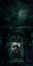 Halloween Witch Standing Over Ancient Castle Window, Full Moon With Spooky Cloudy Sky, Halloween Mystery Concept