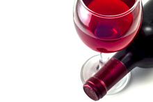 Glass And Bottle Of Red Wine On A White Background.