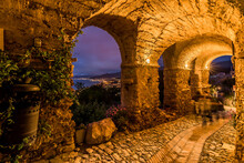 Borgio Verezzi, Italy. May 22th, 2021. The Suggestive Ancient Arcades Of Via Roccaro In The Evening With The Panorama Of The Ligurian Riviera In The Background.