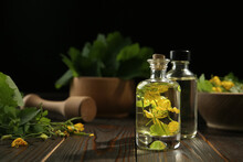 Bottles Of Celandine Tincture And Plant On Wooden Table, Space For Text