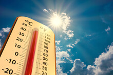 Low Angle View Thermometer On Blue Sky With Sun Shining In Summer Show Higher Weather, Concept Global Warming