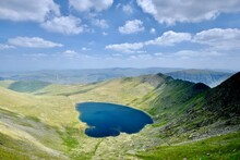 Striding Edge And Red Tarn From Helvellyn In The Lake District