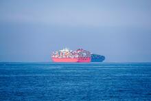Cargo Ship In Ocean Waiting To Port