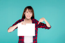 Beautiful Portrait Young Asian Woman Presenting With Blank Paper Sheet, Asia Girl Wear Travel Summer Fashion With Happy Pointing Empty Board Or Card Isolated On Blue Background.
