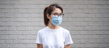 Woman Wearing Medical Face Mask, Prevent Coronavirus Or Corona Virus Disease (Covid-19). Health Concept