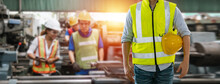 Man Engineering Wearing Uniform Safety In Factory With Blurred  Background Team Worker At Industry. Foreman Manufacturing Professional Workshop.