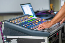 Sound Engineer Working At Mixing Panel