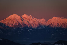 Kamnik-Savinja Alps In Slovenia In Red Sunset