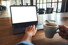 Mockup Image Of A Woman Using And Touching On Laptop Touchpad With Blank White Desktop Screen While Drinking Coffee