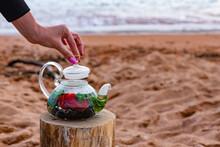 Girl Brews Healthy Fruit Tea Outdoors On The Seashore