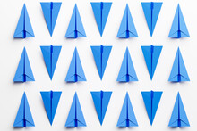 Set Of Blue Paper Airplanes On White Background. Repeating Pattern. 3d Render