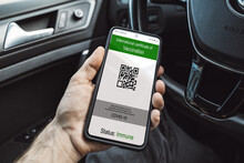 Health Passport - Male Hand Of Driver Of Car Holds Smartphone With Health Certificate - Green Immunity Certificate Covid-19 Vaccination Proof - Digitaler Impfpass