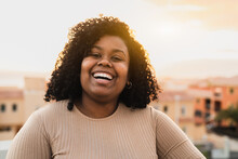 Happy Latin Young Woman Having Fun Laughing In Front Of Camera On House Patio