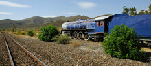 Western Cape, South Africa. 2010.  Vintage Steam Engine Painted Blue With Red Windows And White Wheels.
