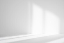 Abstract White Studio Background For Product Presentation. Empty Room With Shadows Of Window. Display Product With Blurred Backdrop.
